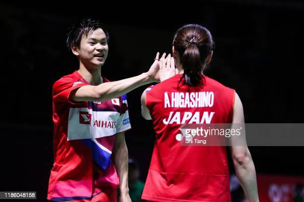 Yuta Watanabe and Arisa Higashino of Japan react in the Mixed Doubles second round match against Ren Xiangyu and Zhou Chaomin of China on day three...