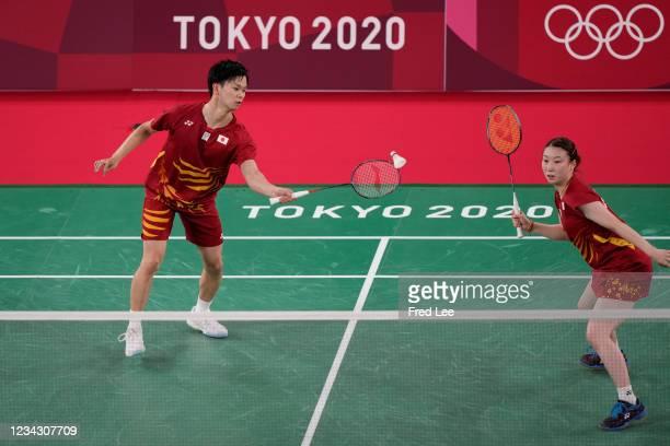 Yuta Watanabe and Arisa Higashino of Team Japan compete against Tang Chun Man and Tse Ying Suet of Team Hong Kong China during the Mix Doubles Bronze...