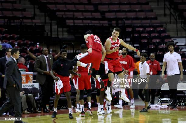Yuta Watanabe and Dusty Hannahs of the Memphis Hustle celebrate against the Delaware Blue Coats during an NBA GLeague game on January 22 2020 at...