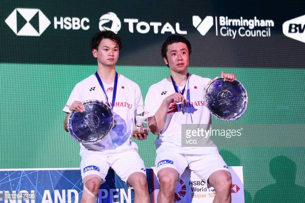Yuta Watanabe and Hiroyuki Endo of Japan pose with their trophies after the Men's Double final match against Marcus Fernaldi Gideon and Kevin Sanjaya...