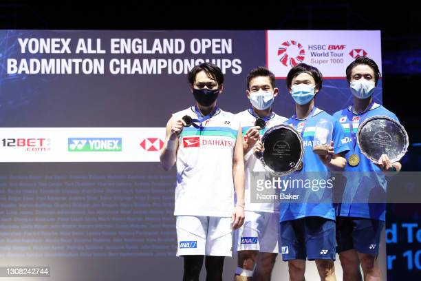 Yuta Watanabe and Hiroyuki Endo pose with the trophy after their victory in the Men's Double final with Takeshi Kamura and Keigo Sonoda of Japan...