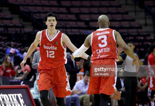 Yuta Watanabe and Jevon Carter of the Memphis Hustle celebrate against the Sioux Falls Skyforce during an NBA GLeague game on March 11 2019 at...