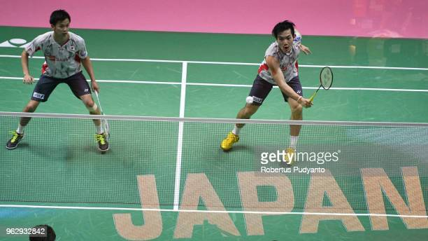 Yuta Watanabe and Keigo Sonoda of Japan compete against Li Junhui and Liu Yuchen of China during the Thomas Cup Final match on day eight of the BWF...