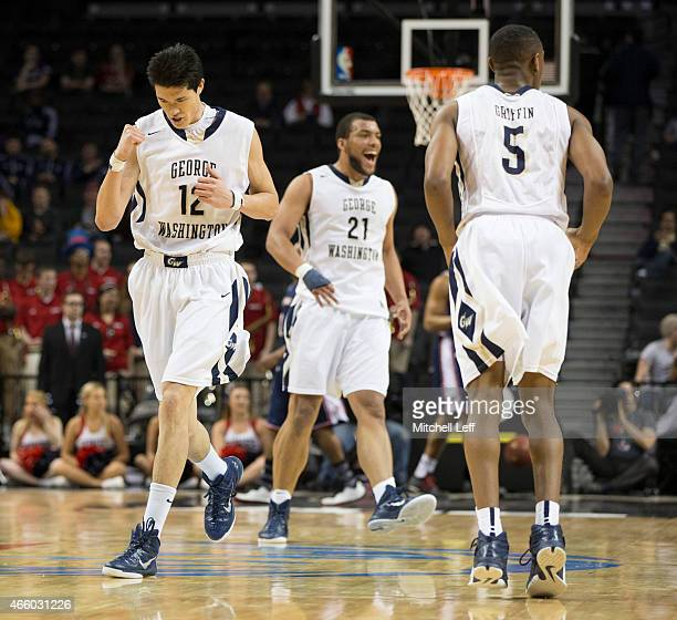 Yuta Watanabe Kevin Larsen and Nick Griffin of the George Washington Colonials celebrate during the game against the Duquense Dukes in the second...