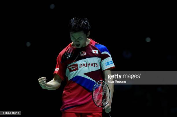 Yuta Watanabe of Japan celebrates in the mixed doubles match with partner Arisa Higashino of Japan after defeating Mathias Christiansen and Alexandra...