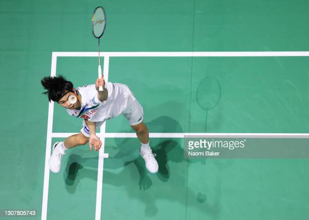 Yuta Watanabe of Japan returns a shot during his Men's doubles match with Hiroyuki Endo of Japan against Yew sin Ong and Ee Yi Teo of Malaysia during...