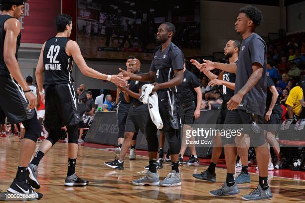 Yuta Watanabe of the Brooklyn Nets exchanges handshakes with his teammates during the game against the Houston Rockets during the 2018 Las Vegas...