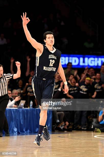 Yuta Watanabe of the George Washington Colonials celebrates hitting a three point shot during the NIT SemiFinal Championship game against the San...