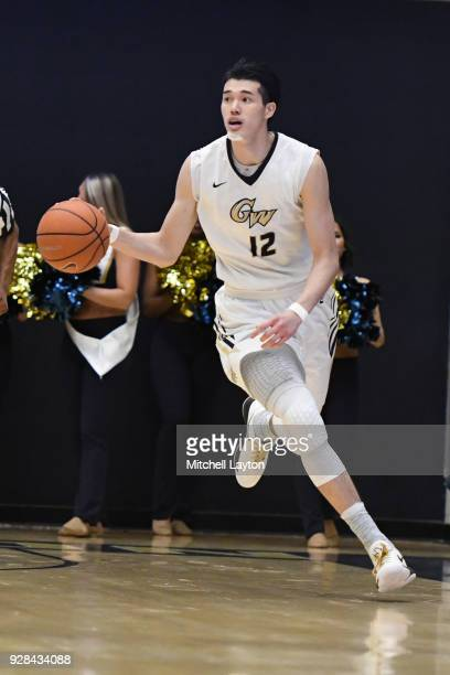 Yuta Watanabe of the George Washington Colonials dribbles up court during a college basketball game against the Fordham Rams at the Smith Center on...