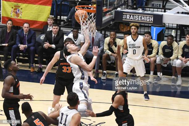 Yuta Watanabe of the George Washington Colonials drives to the basket during a college basketball game against the Princeton Tigers at the Smith...
