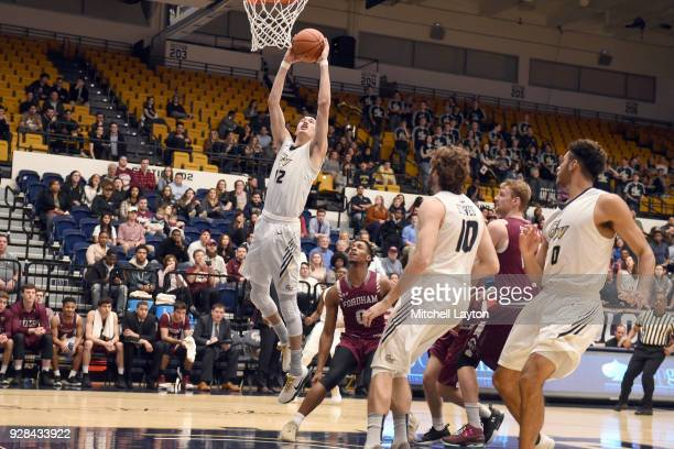 Yuta Watanabe of the George Washington Colonials drives to the basket during a college basketball game against the Fordham Rams at the Smith Center...