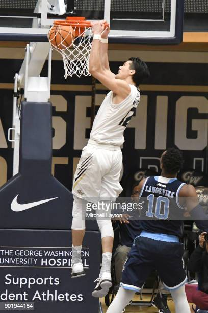 Yuta Watanabe of the George Washington Colonials dunks the ball during a college basketball game against the Rhode Island Rams at the Smith Center on...