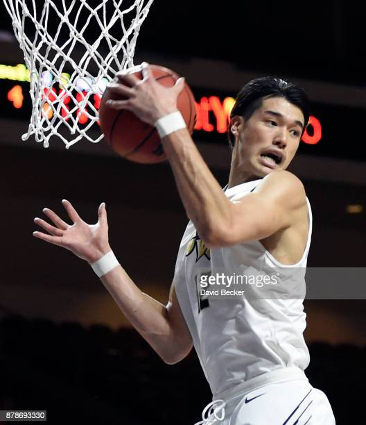 Yuta Watanabe of the George Washington Colonials grabs a rebound against the Kansas State Wildcats during the 2017 Continental Tire Las Vegas...