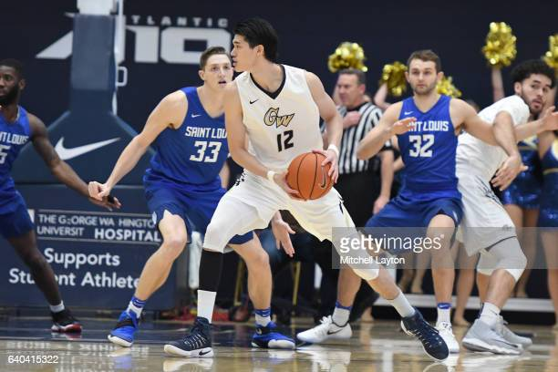 Yuta Watanabe of the George Washington Colonials looks to pass the ball during a college basketball game against the Saint Louis Billikens at the...