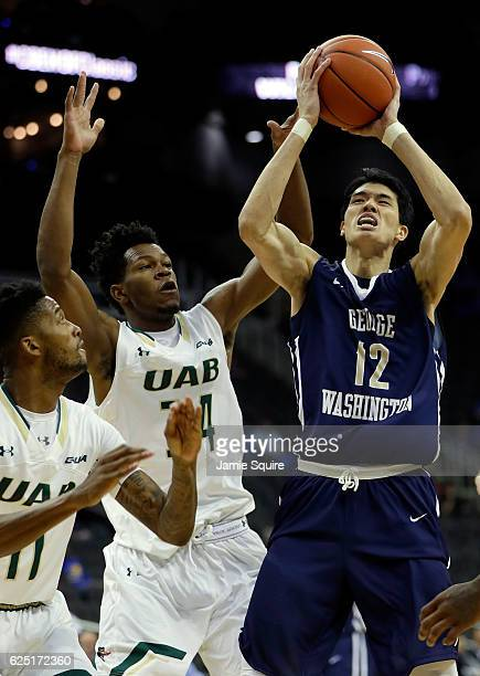 Yuta Watanabe of the George Washington Colonials shoots as William Lee and Dirk Williams of the UAB Blazers defend during the CBE Hall of Fame...