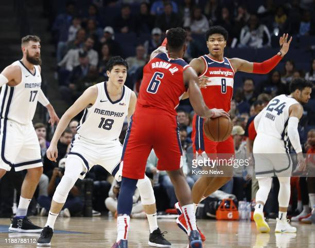Yuta Watanabe of the Memphis Grizzlies guards Troy Brown of the Washington Wizards during an NBA match in Memphis Tennessee on Dec 14 2019 The...
