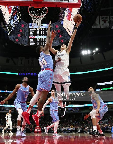 Yuta Watanabe of the Memphis Grizzlies puts up a shot against Wendell Carter Jr #34 of the Chicago Bulls at the United Center on December 04 2019 in...