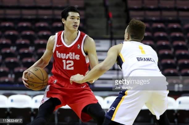 Yuta Watanabe of the Memphis Hustle dribbles against Stephaun Branch of the Salt Lake City Stars during an NBA GLeague game on February 20 2019 at...