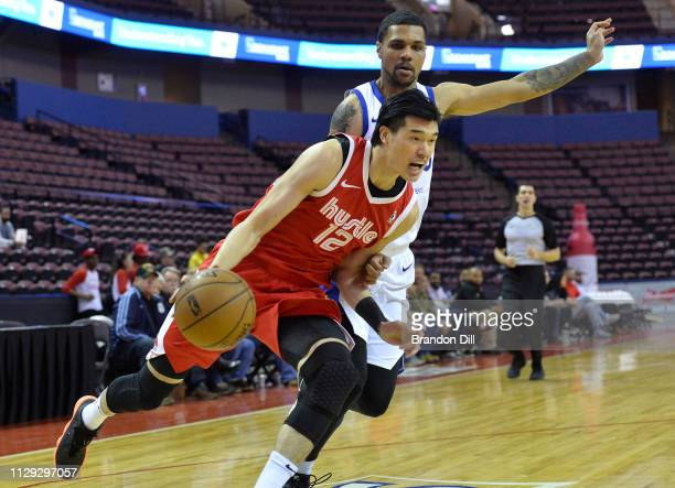 Yuta Watanabe of the Memphis Hustle drives against Michael Gbinije of the Santa Cruz Warriors at Landers Center in an NBA GLeague game on March 8...