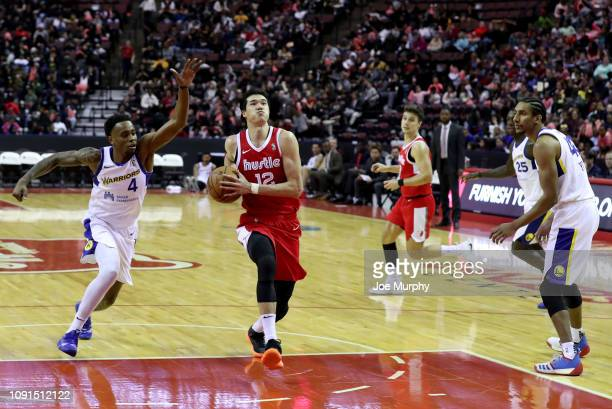 Yuta Watanabe of the Memphis Hustle drives to the basket against Antonius Cleveland of the Santa Cruz Warriors during an NBA GLeague game on January...