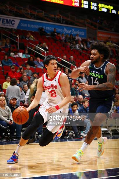 Yuta Watanabe of the Memphis Hustle handles the ball against Jordan Murphy of the Iowa Wolves in an NBA GLeague game on January 4 2020 at the Wells...