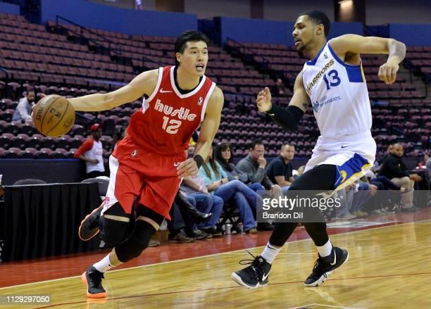 Yuta Watanabe of the Memphis Hustle handles the ball against Michael Gbinije of the Santa Cruz Warriors at Landers Center in an NBA GLeague game on...