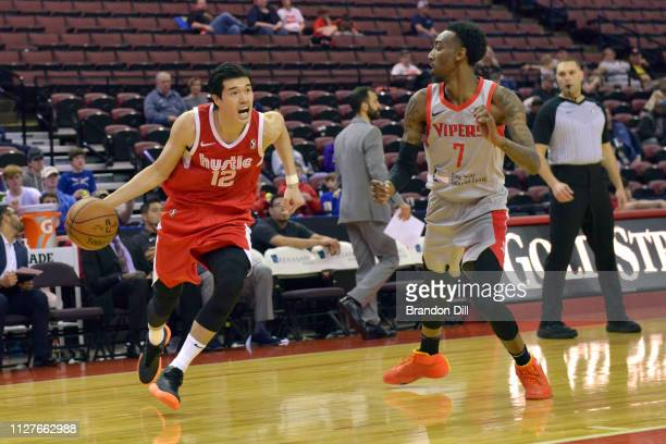 Yuta Watanabe of the Memphis Hustle handles the ball against Tim Bond of the Rio Grande Valley Vipers at Landers Center in an NBA GLeague game on...