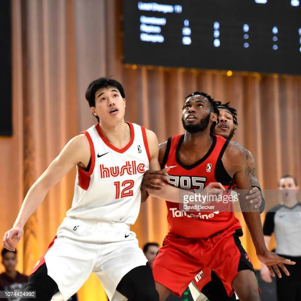 Yuta Watanabe of the Memphis Hustle plays defense against Roger Moute a Bidias of the Raptors 905 during the NBA G League Winter Showcase at Mandalay...