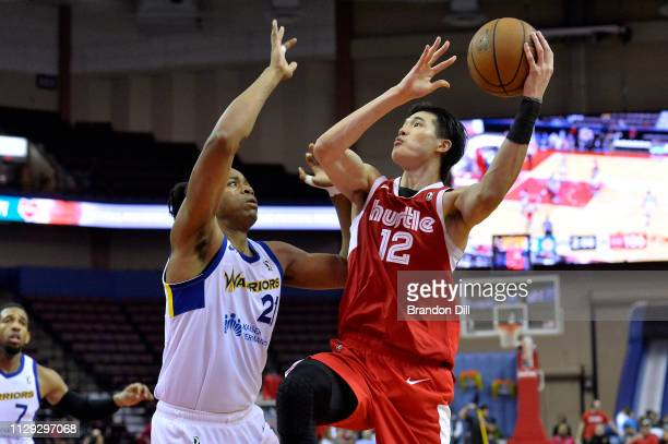 Yuta Watanabe of the Memphis Hustle shoots against Deyonta Davis of the Santa Cruz Warriors at Landers Center in an NBA GLeague game on March 8 2019...