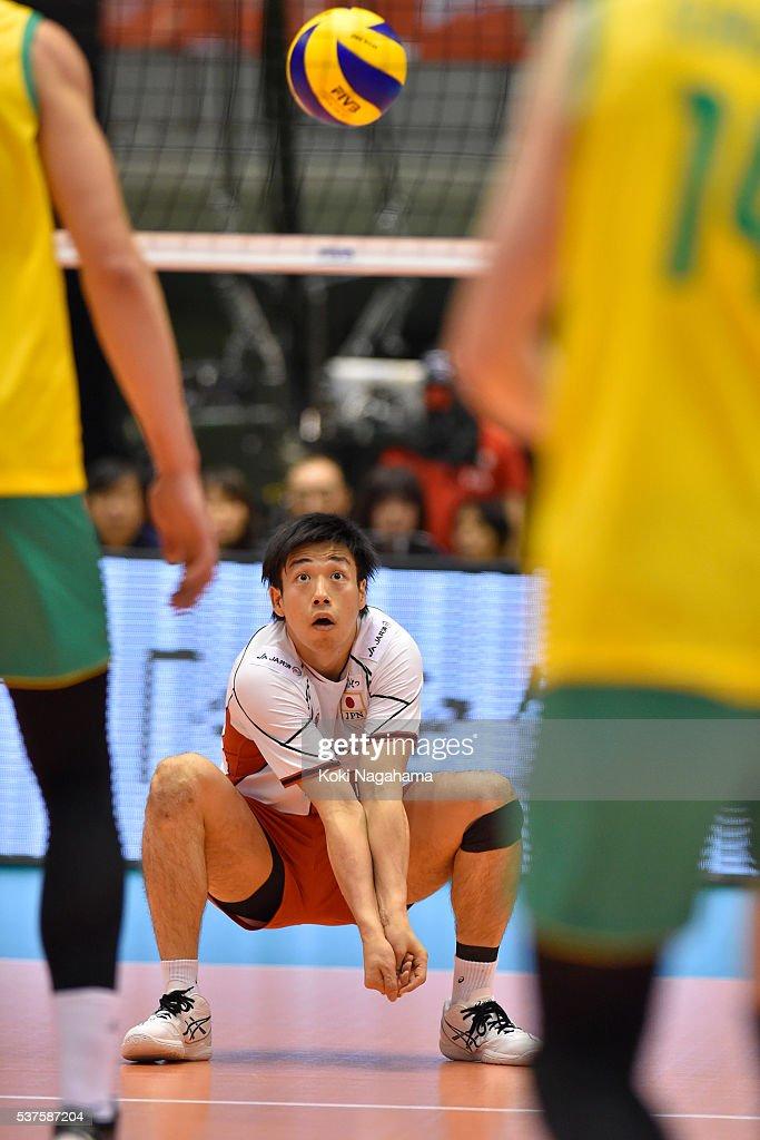 Yuta Yoneyama #18 of Japan receives the ball during the Men's World Olympic Qualification game between Australia and Japan at Tokyo Metropolitan Gymnasium on June 2, 2016 in Tokyo, Japan.