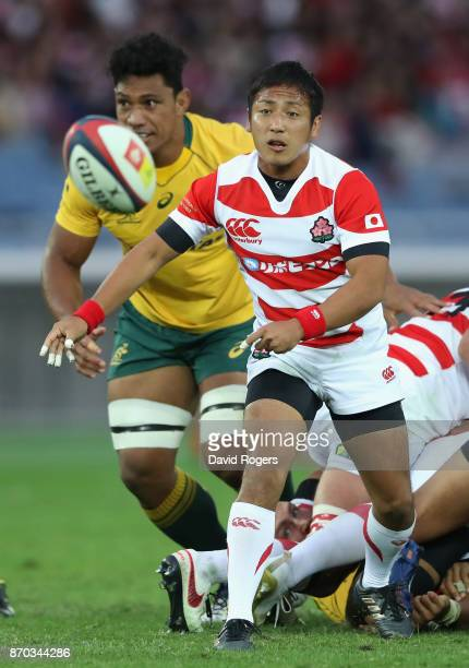 Yutaka Nagare of Japan passes the ball during the rugby union international match between Japan and Australia Wallabies at Nissan Stadium on November...