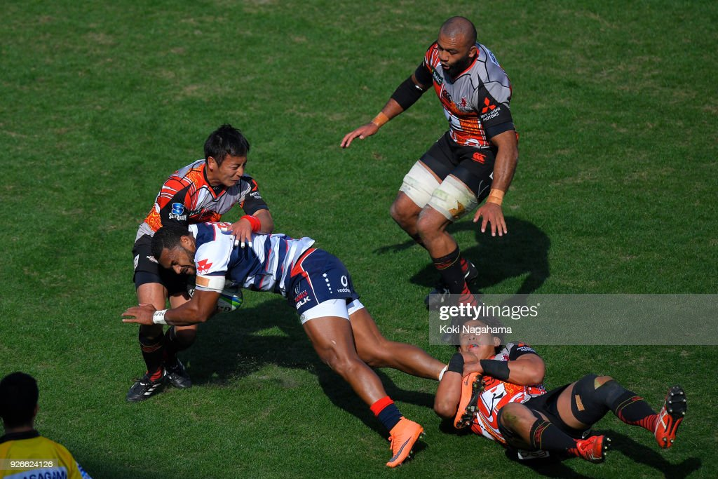 Yutaka Nagere #9 of Sunwolves and Yoshitaka Tokunaga #20 of Sunwolves make a tackle on Sefa Naivalu #11 during the Super Rugby round 3 match between Sunwolves and Rebels at the Prince Chichibu Memorial Ground on March 3, 2018 in Tokyo, Japan.