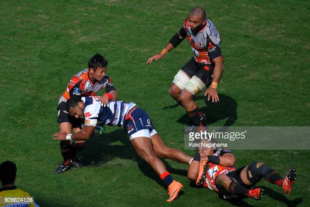 Yutaka Nagere of Sunwolves and Yoshitaka Tokunaga of Sunwolves make a tackle on Sefa Naivalu during the Super Rugby round 3 match between Sunwolves...