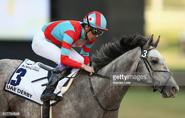 Yutaka Take celebrates after riding Lani to victory in the UAE Derby Sponsored By The Saeed Mohammed Al Naboodah Group as part of the Dubai World Cup...