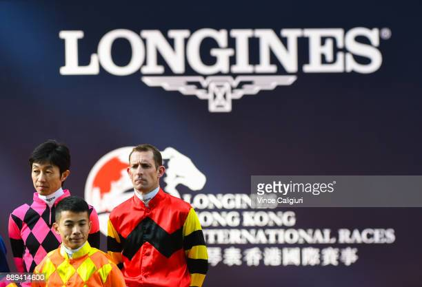 Yutaka Take Derek Leung and Hugh Bowman pose at the Opening ceremony during Longines Hong Kong International Race Day at Sha Tin Racecourse on...