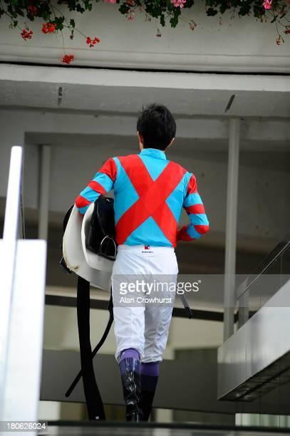 Yutaka Take makes his way back to the weighing room at Longchamp racecourse on September 15 2013 in Paris France