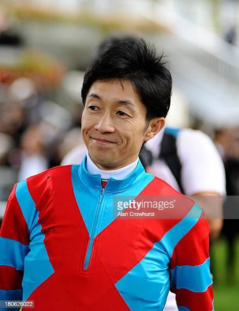 Yutaka Take poses at Longchamp racecourse on September 15 2013 in Paris France
