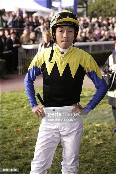 Yutaka Take rides Deep Impact in Paris France on October 01 2006