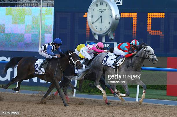 Yutaka Take rides Lani to victory in the UAE Derby Sponsored By The Saeed Mohammed Al Naboodah Group as part of the Dubai World Cup at Meydan...