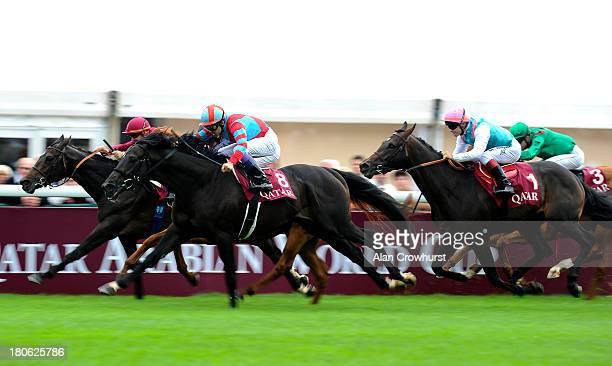 Yutaka Take riding Kizuna win The Qatar Prix Niel at Longchamp racecourse on September 15 2013 in Paris France