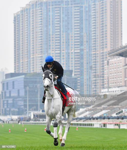 Yutaka Take riding Smart Layer from Japan during a Longines Hong Kong International Trackwork Session at Sha Tin racecourse on December 7 2017 in...