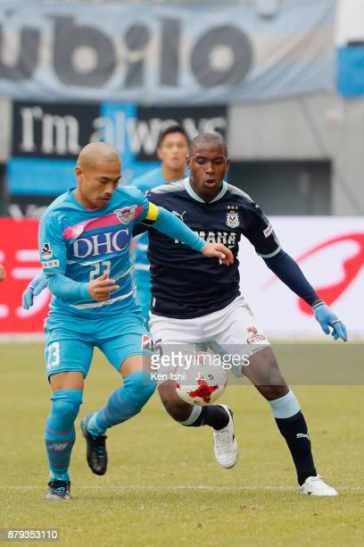 Yutaka Yoshida of Sagan Tosu and Adailton of Jubilo Iwata compete for the ball during the JLeague J1 match between Sagan Tosu and Jubilo Iwata at...