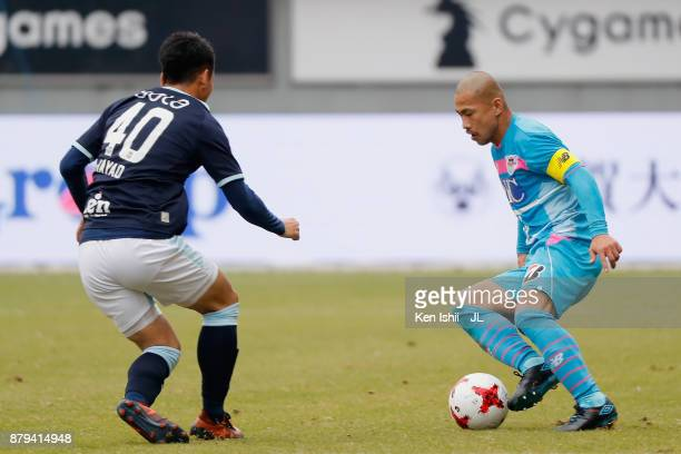 Yutaka Yoshida of Sagan Tosu takes on Hayao Kawabe of Jubilo Iwata during the JLeague J1 match between Sagan Tosu and Jubilo Iwata at Best Amenity...