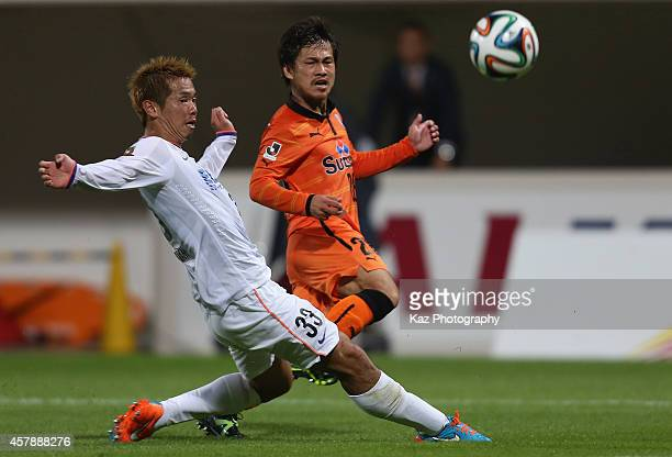 Yutaka Yoshida of Shimizu SPulse and Tsukasa Shiotani of Sanfrecce Hiroshimacompete for the ball during the JLeague match between Shimizu SPulse and...