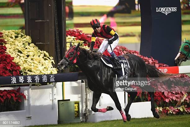 Yutake Take riding A Shin Hikari from Japan wins Race 8 The Longines Hong Kong Cup during the Hong Kong International Races at Sha Tin racecourse on...