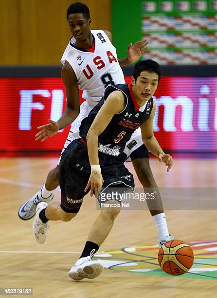 Yutaro Hayashi of Japan drives the ball against VJ King of the United States during the FIBA U17 World Championships Group Match between Japan and...