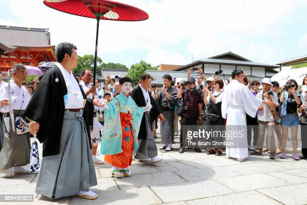 Yutaro Kobayashi acts as 'Chigo' attends the 'OsendonoGi' ritual to pray for the sucess as the start of the Kyoto Gion Festival at the Yasaka Jinja...