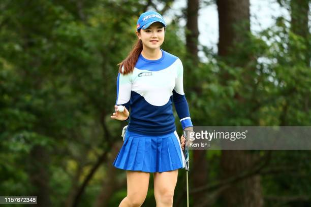 Yuting Seki of China acknowledges fans after the birdie on the 1st green during the final round of the Yupiteru Shizuoka Shimbun SBS Ladies at...