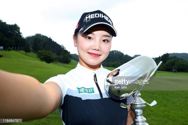 Yuting Seki of China imitates a selfie with the trophy after winning the tournament following the final round of the Nichi-Iko Women's Open at Yatsuo...