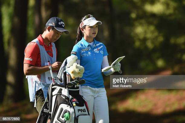 Yuting Seki of China looks at her yardage book on the 4th hole during the second round of the HokennoMadoguchi Ladies at the Fukuoka Country Club...